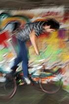 Blurred Mountainbike rider, Southbank Undercroft, London - David Mansell - 2010s,2012,activities,adolescence,adolescent,adolescents,bicycle,bicycles,BICYCLING,Bicyclist,Bicyclists,bike,bikes,boy,boys,child,CHILDHOOD,children,cities,city,cycle,cycles,cycling,Cyclist,Cyclists,