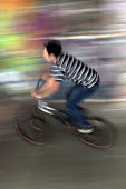 Blurred Mountainbike rider, Southbank Undercroft, London - David Mansell - 2010s,2012,activities,adolescence,adolescent,adolescents,boy,boys,child,CHILDHOOD,children,cities,city,enjoying,enjoyment,fast,fun,having fun,juvenile,juveniles,kid,kids,Leisure,LFL,LIFE,London,Long l