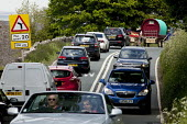 Appleby Horse Fair, Cumbria. Traffic jam as horse drawn caravans travel to the Fair. Traffic comes to standstill on the outskirts of Kirkby Stephen. - David Mansell - 04-06-2015