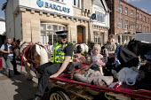 Appleby Horse Fair, Cumbria. Police take a lesson in parking a horse in Kirkby Stephen. - David Mansell - 2010s,2015,adult,adults,animal,animals,BAME,BAMEs,BME,bmes,cart,child,CHILDHOOD,children,CLJ,diversity,domesticated ungulate,domesticated ungulates,equestrian,equine,ethnic,ethnicity,Fair,gipsey,Gipse