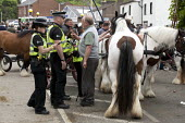 Appleby Horse Fair, Cumbria, Police warning Tom Harker a horse dealer to slow down when showing horses. - David Mansell - , CLJ,2010s,2015,adult,adults,age,ageing population,animal,animals,BAME,BAMEs,BME,bmes,cart,CLJ,communicating,communication,conversation,conversations,dealer,dealers,dealing,dialogue,discourse,discuss