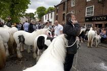 Appleby Horse Fair, Cumbria, Horse dealer talking on his mobile phone - David Mansell - 05-06-2015