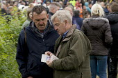 Appleby Horse Fair, Cumbria, Chris Booth on left completing a horse sale - David Mansell - ,2010s,2015,animal,animals,BAME,BAMEs,BME,bmes,buy,buyer,buyers,buying,cash,commodities,commodity,communicating,communication,conversation,conversations,dialogue,discourse,discuss,discusses,discussing