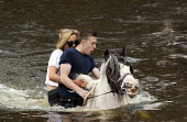 Appleby Horse Fair, Cumbria, washing horses in the River Eden. Young people often first meet their future marriage partners at Appleby Fair. Riding together are Arran Boot and Jasmine May, both 17 yea... - David Mansell - 2010s,2015,adult,adults,animal,animals,Appleby,BAME,BAMEs,BME,bmes,boyfriend,BOYFRIENDS,couple,COUPLES,diversity,domesticated ungulate,domesticated ungulates,enjoy,enjoying,enjoyment,equestrian,equine