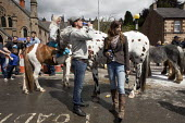 Appleby Horse Fair, Cumbria, horse dealing along the Sands - David Mansell - ,2010s,2015,adult,adults,alcohol,animal,animals,BAME,BAMEs,BME,bmes,can,cans,couple,COUPLES,dealing,diversity,domesticated ungulate,domesticated ungulates,drink,drinker,drinkers,drinking,drinks,equest