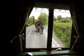 Appleby Horse Fair, Cumbria, David Barnes in a horse drawn caravan returning home using the spectacular scenic open moorland route from Kirkby Stephen to Sedbergh. - David Mansell - 2010s,2015,animal,animals,Appleby,BAME,BAMEs,BME,bmes,caravan,caravans,country,countryside,diversity,domesticated ungulate,domesticated ungulates,driver,drivers,driving,equestrian,equine,ethnic,ethnic
