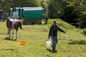 Appleby Horse Fair, Cumbria George Driver 82 years watering the horses before they leave Malmerby on the return journey - David Mansell - 2010s,2015,animal,animals,caravan,caravans,country,countryside,domesticated ungulate,domesticated ungulates,Driver,DRIVERS,DRIVING,equestrian,equine,Fair,gipsey,Gipsey Gipsy Gypsey,gypse,gypsey,Gypsie