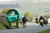 Appleby Horse Fair, Cumbria, motorcycles pass horse drawn caravans returning along the Hartside Pass - David Mansell - ,2010s,2015,animal,animals,bike,bikes,caravan,caravans,country,countryside,domesticated ungulate,domesticated ungulates,driver,drivers,driving,enjoy,enjoying,enjoyment,equestrian,equine,Fair,gipsey,Gi
