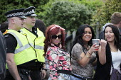 Wickham Horse Fair a traditional one day annual event, Hampshire. Young women drinking and police - David Mansell - 20-05-2015