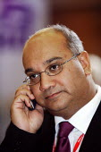 Keith Vaz MP at the Labour Party Conference Bournemouth 2003. Seen using his mobile telephone. - David Mansell - 2000s,2003,BME Black minority ethnic,call,calls,CELLULAR,communicating,communication,Conference,conferences,mobile phone,mobile phone,mp,Party,PHONE,PHONES,pol politics,telephone,telephones