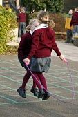 Wedmore First School, a 210 pupil village school in Wedmore, Somerset, run by Somerset LEA. Two school girls seen during their morning break, exercising by using a skipping rope supplied by the school... - David Mansell - 08-02-2005