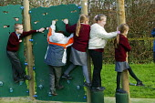 Wedmore First School, a 210 pupil village school in Wedmore, Somerset, run by Somerset LEA. Girls are seen on the climbing wall of the activity trail funded by the PTA during their lunch break.play ti... - David Mansell - 08-02-2005