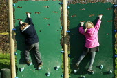 Wedmore First School, a 210 pupil village school in Wedmore, Somerset, run by Somerset LEA. The reception class, the four to five year old children are seen on the climbing wall of the activity trail... - David Mansell - 08-02-2005
