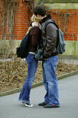 Birmingham University - student undergraduates on campus. A young couple obviously in love seen holding each other. - David Mansell - 15-03-2005