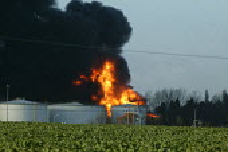 A plume of black smoke filling the sky as the Buncefield oil depot burns. Hemel Hempstead - David Mansell - 12-12-2005