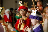 Four and five year old nursery preschool children who attend the Springfield Primary School, Welwyn Garden City, Hertfordshire, in a Christian Christmas nativity play, the boys are dressed up as the w... - David Mansell - 2000s,2005,ACE arts culture,BAME,BAMEs,black,bme,BME Black minority ethnic,bmes,boy,boys,CARE,carer,carers,child,CHILD CARE,CHILDCARE,CHILD-CARE,CHILDHOOD,CHILDMINDING,children,christian,Christmas,CRE