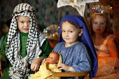 Four and five year old nursery preschool children who attend the Springfield Primary School, Welwyn Garden City, Hertfordshire, are seen taking part in a Christian Christmas nativity play, the two chi... - David Mansell - 2000s,2005,ACE arts culture,babies,baby,boy,boys,CARE,carer,carers,Child,child care,childcare,CHILD-CARE,CHILDHOOD,childminding,children,Christmas,CRECH,creche,creches,cute,day care,daycare,EARLY,EARL