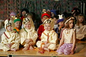 Four and five year old nursery preschool children who attend the Springfield Primary School, Welwyn Garden City, Hertfordshire, are seen taking part in a Christian Christmas nativity play. - David Mansell - 2000s,2005,ACE arts culture,boy,boys,CARE,carer,carers,child,CHILD CARE,CHILDCARE,CHILD-CARE,CHILDHOOD,CHILDMINDING,children,Christmas,CRECH,creche,creches,cute,day care,daycare,dressing up,EARLY,earl