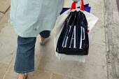 Shopper in Regent Street, London, carrying her Gap shopping bag. - David Mansell - 24-04-2006