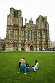 Tourists sitting on the grass on Cathedral Green, Wells Cathedral, Somerset - David Mansell - 24-10-2007