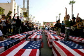 Protests in Hollywood against the U.S. war in Iraq. - David Bacon - 2000s,2004,activist,activists,against,America,anti war,Antiwar,CAMPAIGN,campaigner,campaigners,CAMPAIGNING,CAMPAIGNS,casket,coffin,coffins,DEMONSTRATING,DEMONSTRATION,demonstration American,DEMONSTRAT