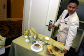 A room service worker at the Beverly Hilton Hotel, one of the most luxurious in the US. Providing food and drinks served to hotel guests in their rooms - David Bacon - 24-11-2006