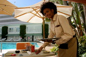Waitress serving at the Beverly Hilton Hotel, one of the most luxurious in the US - David Bacon - 24-11-2006