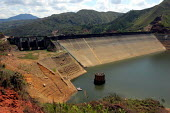 The dam on the Rio Salvajina was built in 1984. Thousands of the indigenous population were displaced and forced to leave the vally and the environment scarred and degraded.. The dam and hydroelectric... - David Bacon - 25-10-2006