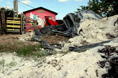 Maquiladora workers and their families live in the Derechos Humanos and Fuerza y Unidad barrios in Matamoros. The neighborhoods are contaminated by toxic chemicals dumped by factories into the canal w... - David Bacon - 05-11-2006