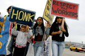 Immigrant workers from the Woodfin Suites hotel and their supporters protest. Hotel managers have been trying to fire 20 workers, accusing them of lacking legal permission to work, and alleging that t... - David Bacon - 10-04-2007
