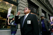 Security guards in San Francisco buildings march to pressure security companies and employers into improving wages and conditions for guards, and signing a new union contract with Service Employees In... - David Bacon - 2000s,2007,activist,activists,America,BAME,BAMEs,BME,bmes,buildings,CAMPAIGN,campaigner,campaigners,CAMPAIGNING,CAMPAIGNS,DEMONSTRATING,DEMONSTRATION,demonstration American,DEMONSTRATIONS,diversity,EA