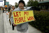 Immigrant Latino workers from the Woodfin Suites hotel and their supporters rally outside the hotel. Hotel managers fired 20 workers, accusing them of lacking legal permission to work, and alleging th... - David Bacon - 02-06-2007