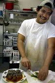 The cook at La Veracruzana market. Laurel, Mississippi is a town with many Mexican immigrants - David Bacon - 14-01-2008