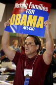 Union members show their support for presidential candidate Barack Obama at the convention of the California Labor Federation. Oakland, CA. - David Bacon - 2000s,2008,AFL CIO,African American,African Americans,America,American,americans,BAME,BAMEs,Black,BME,bmes,California,campaign,campaigning,CAMPAIGNS,candidate,CANDIDATES,DEMOCRACY,Democratic Party,Dem