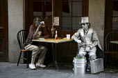Workers of the French Quarter take a break. New Orleans. A living statue of a businessman has a beer and a cigerette. - David Bacon - 2000s,2008,ACE arts culture & entertainment American,ace culture,African American,African Americans,alcohol,America,artist,ARTISTS,BAME,BAMEs,bar,bars,beer,black,BME,BME Black minority ethnic,bmes,bre