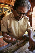 Artist Isaac Vasquez who is famous for his weaving, works in his studio. - David Bacon - 01-11-2008