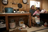 The home of a Triqui migrant family, a plywood shack outside Hollister, California, USA Triquis are one of the many indigenous groups who have migrated to to work as farm workers - David Bacon - 21-02-2009