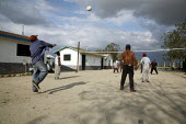 Indigenous Mixtec migrant workers from Oaxaca, playing volleyball in their housing complex. - David Bacon - 10-04-2009