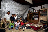 Oxnard, California. The family of Lino Reyes are Mixtec migrants from Oaxaca. They work in the strawberry fields, and live in the garage of a house on the outskirts of town. - David Bacon - 24-04-2009