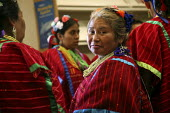 Triqui women dance to traditional music from their communities in Oaxaca, at a celebration in the public library. Over 1000 Triquis live in Greenfield, one of the main centers of their community in th... - David Bacon - 2000s,2009,ace,ACE arts culture American,America,Amerindian,Amerindians,apparel,BAME,BAMEs,BME,bmes,California,CELEBRATE,CELEBRATING,celebration,CELEBRATIONS,clothes,clothing,communities,community,cos