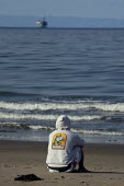 A teenager looking out at a oil rig in the Santa Barbara Channel, where a huge oil spill in January 1969 covered the beaches. Today oil companies are pushing again for concessions for oil drilling in... - David Bacon - 10-06-2009