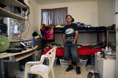 A young Mixtec man from Puebla in his room. The Campo Rojo (Red Camp) is a labor camp for Mexican farmworkers, operated by labor contractor John Hernandez. Most of the workers living in this camp are... - David Bacon - 23-07-2009