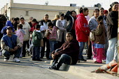 The poor queue for food at a food distribution project organised every month by Hope for the Heart in Hayward, California, USA. Many people begin lining up for food the day before, and sleep on the si... - David Bacon - 15-08-2009