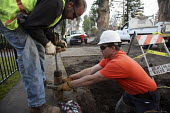 A worker for the City of Burlingame prepares to tap a water main to provide water service. - David Bacon - 17-12-2009
