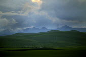 Winter clouds over the Pacheco Pass, a fertile agricultural valley in California. - David Bacon - 23-01-2010