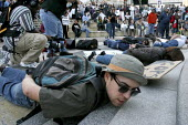 """A rally protesting at the killing of Oscar Grant, a young African American, by an officer of the Bay Area Rapid Transit police. Protesters lie on the ground, and shout out """"Don't Shoot!"""" to remind onl... - David Bacon - American,2000s,2009,activist,activists,adult,adults,African,America,American,americans,CAMPAIGN,campaigner,campaigners,CAMPAIGNING,CAMPAIGNS,dead,death,deaths,DEMONSTRATING,demonstration,DEMONSTRATION"""