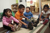 Children of migrants, many of them from indigenous Mixtec families from Oaxaca, in a day care nursery school program run by Migrant Head Start. California USA - David Bacon - , American,2010,2010s,America,American,americans,Amerindian,Amerindians,BAME,BAMEs,BME,bmes,boy,boys,California,CARE,carer,carers,child,Child Care,childcare,CHILD-CARE,CHILDHOOD,CHILDMINDING,children,