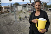 Ana Sanchez lives in the St. Anthony's Mobilehome Park near Thermal, in the desert in Coachella Valley. The water supply of the park in contaminated, groundwater wells are tainted with naturally occur... - David Bacon - 06-12-2010