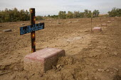 Holtville Cemetery where immigrants are buried who try to cross the US and Mexican border illegally. Most graves are without a name and marked John Doe or Jane Doe with a brick. Thought to be a mass g... - David Bacon - 04-12-2010