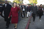 Newly elected Oakland Mayor Jean Quan walks through the city on her inauguration day. She is the first Chinese American woman elected mayor. - David Bacon - American,2010s,2011,African American,African Americans,America,American,americans,BAME,BAMEs,black,BME,bmes,CELEBRATE,celebrating,celebration,CELEBRATIONS,Chinatown,Chinese,DEMOCRACY,Democratic Party,